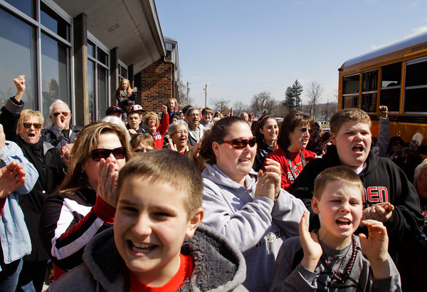 Borden fans cheer as the boy's basketball team boards their bus on Friday afternoon before heading to Indianapolis to take on Triton in the Class A state championship on Saturday morning. Staff photo by Christopher Fryer