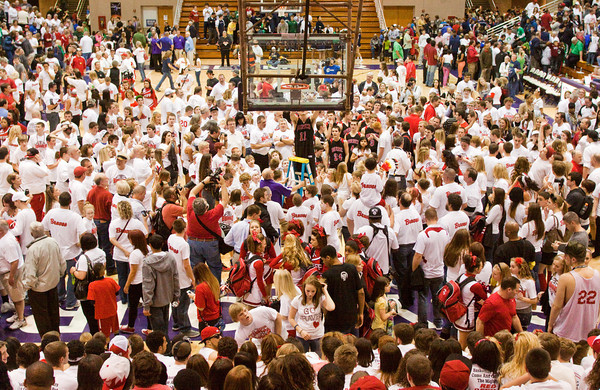 Fans look on as Borden cuts down the net after their 47-44 victory over University in the semi-state tournament at Seymour on Saturday. The Braves will face Triton for the Class A state championship in Indianapolis on Saturday March 23. Staff photo by Christopher Fryer