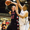 Borden junior Garrett Vick goes up for a shot during their game against University in the semi-state tournament at Seymour on Saturday. Borden won the game, 47-44. The Braves will face Triton for the Class A state championship in Indianapolis on Saturday March 23. Staff photo by Christopher Fryer