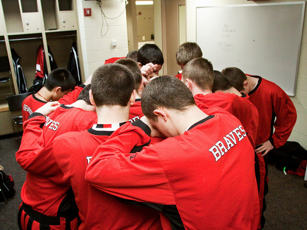 Borden players huddle up and pray in the locker room before their game against Triton for the Class A state championship at Bankers Life Fieldhouse in Indianapolis on Saturday. The Braves won the game, 55-50. Staff photo by Christopher Fryer