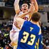 Borden forward Garrett Vick goes up for a shot during their game against Triton for the Class A state championship at Bankers Life Fieldhouse in Indianapolis on Saturday. The Braves won the game, 55-50. Staff photo by Christopher Fryer