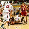 Jeffersonville senior Jacquari Chandler scrambles for a loose ball during their game against Evansville Harrison in the regional tournament at Seymour on Saturday. Jeffersonville won the game, 73-62. The Red Devils went on to defeat Franklin Central 85-69 for the regional title on Saturday night. Staff photo by Christopher Fryer