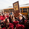 Borden senior Michael Lynch holds their Class A state championship trophy over his head as the team is welcomed back to their school following their 55-50 victory over Triton at Bankers Life Fieldhouse in Indianapolis on Saturday. Staff photo by Christopher Fryer