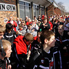 Fans cheer as the Borden boy's basketball team boards their bus on Friday afternoon before heading to Indianapolis to take on Triton in the Class A state championship on Saturday morning. Staff photo by Christopher Fryer