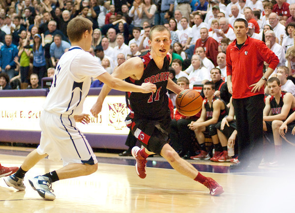 Borden senior Billy Kirchgessner drives to the basket during their game against University in the semi-state tournament at Seymour on Saturday. Borden won the game, 47-44. The Braves will face Triton for the Class A state championship in Indianapolis on Saturday March 23. Staff photo by Christopher Fryer