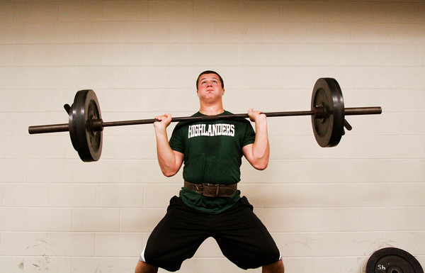 Floyd Central High School senior Joe Wolf, of Greenville, does power cleans in the weight room during pre-season football conditioning on Thursday morning. Staff photo by Christopher Fryer