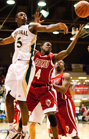Jeffersonville junior Leonard Kwitonda fights for a rebound during their game against Indianapolis Cathedral in the semi-state tournament at Seymour on Saturday. Indianapolis Cathedral won the game, 74-53. Staff photo by Christopher Fryer