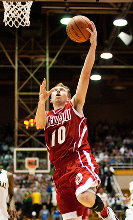 Jeffersonville junior Drew Ellis goes up for a shot during their game against Indianapolis Cathedral in the semi-state tournament at Seymour on Saturday. Indianapolis Cathedral won the game, 74-53. Staff photo by Christopher Fryer