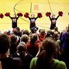 The Borden cheerleaders warm up the crowd at the start of a pep rally to support their boy's basketball team's upcoming state championship game on Saturday. Hundreds of students and community supporters showed up for the event. The Braves will take on Triton for the Class A state championship at Bankers Life Fieldhouse in Indianapolison on Saturday morning. Staff photo by Christopher Fryer