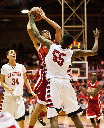 Jeffersonville senior Devin Shackleford fights for a shot during their game against Evansville Harrison in the regional tournament at Seymour on Saturday. Jeffersonville won the game, 73-62. The Red Devils went on to defeat Franklin Central 85-69 for the regional title on Saturday night. Staff photo by Christopher Fryer