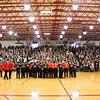 Borden's boy's basketball team takes center court in front of hundreds of fans that came to a pep rally in the school's gym to congratulate the team on their 55-50 victory over Triton in the Class A state championship at Bankers Life Fieldhouse in Indianapolis on Saturday. Staff photo by Christopher Fryer