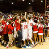 Jeffersonville players and fans celebrate on the court after the Red Devils defeated Franklin Central 85-69 in the championship game of the regional tournament at Seymour on Saturday. Staff photo by Christopher Fryer