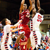 Jeffersonville senior Darryl Baker goes up for a shot during their game against Evansville Harrison in the regional tournament at Seymour on Saturday. Jeffersonville won the game, 73-62. The Red Devils went on to defeat Franklin Central 85-69 for the regional title on Saturday night. Staff photo by Christopher Fryer