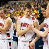 Borden senior Michael Lynch is congratulated by his teammates for earning the Arthur L. Trester Mental Attitude Award in Class A boys' basketball following their 55-50 victory over Triton in the Class A state championship at Bankers Life Fieldhouse in Indianapolis on Saturday. Staff photo by Christopher Fryer