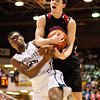 Borden senior Cody Bachman fights for possession of a rebound during their game against University in the semi-state tournament at Seymour on Saturday. Borden won the game, 47-44. The Braves will face Triton for the Class A state championship in Indianapolis on Saturday March 23. Staff photo by Christopher Fryer