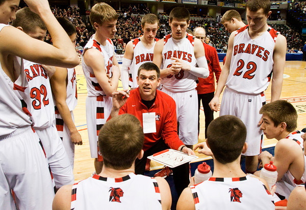 Head Coach Doc Nash talks to his players during a time out in their game against Triton for the Class A state championship at Bankers Life Fieldhouse in Indianapolis on Saturday. The Braves won the game, 55-50. Staff photo by Christopher Fryer