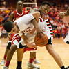Jeffersonville senior Kortrell White fights for possession of a rebound during their game against Evansville Harrison in the regional tournament at Seymour on Saturday. Jeffersonville won the game, 73-62. The Red Devils went on to defeat Franklin Central 85-69 for the regional title on Saturday night. Staff photo by Christopher Fryer