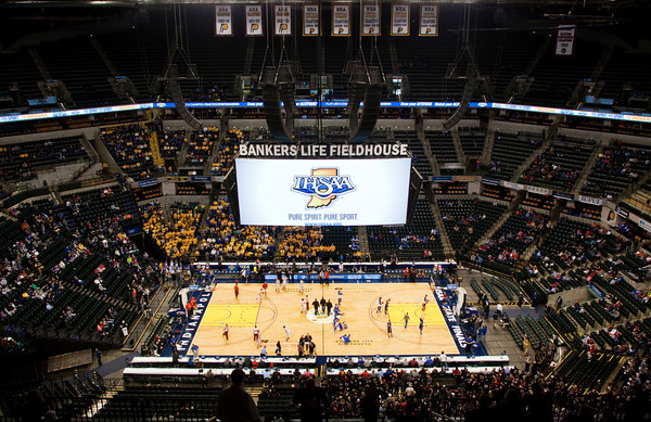 Borden and Triton warm up before their Class A state championship game at Bankers Life Fieldhouse in Indianapolis on Saturday. The Braves won the game, 55-50. Staff photo by Christopher Fryer