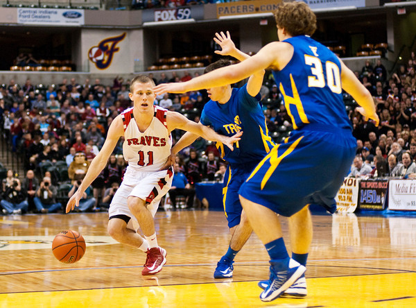 Borden guard Billy Kirchgessner drives to the basket during their game against Triton for the Class A state championship at Bankers Life Fieldhouse in Indianapolis on Saturday. The Braves won the game, 55-50. Staff photo by Christopher Fryer