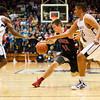 Borden senior Michael Lynch drives to the basket during their game against University in the semi-state tournament at Seymour on Saturday. Borden won the game, 47-44. The Braves will face Triton for the Class A state championship in Indianapolis on Saturday March 23. Staff photo by Christopher Fryer