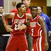 Jeffersonville head coach Chad Gilbert and Jacquari Chandler hold back Darryl Baker after he was fouled by New Albany's Joshua Rogers during the second half of the championship game in the Seymour Sectional on Saturday. Baker was given a technical foul following the incident and Jeffersonville's Keenan Williams was ejected from the game for leaving the bench. Staff photo by Christopher Fryer