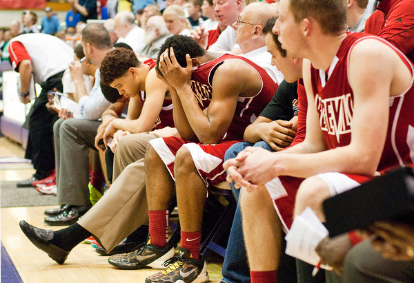 Jeffersonville senior Darryl Baker holds his head in his hands during the end of their 74-53 loss to Indianapolis Cathedral in the semi-state tournament at Seymour on Saturday. Staff photo by Christopher Fryer
