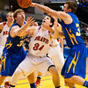 Borden forward Cody Bachman fights for a loose ball under the basket during their game against Triton for the Class A state championship at Bankers Life Fieldhouse in Indianapolis on Saturday. The Braves won the game, 55-50. Staff photo by Christopher Fryer