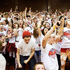 Fans celebrate in the student section after Borden's 47-44 victory over University in the semi-state tournament at Seymour on Saturday. The Braves will face Triton for the Class A state championship in Indianapolis on Saturday March 23. Staff photo by Christopher Fryer