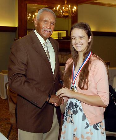 Johnny Wilson with 2013 Johnny Wilson Award nominee Lindsey Kardatzke of Liberty Christian High School.