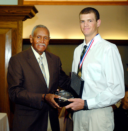 Johnny Wilson presents Kurt Talbert, of Pendleton Heights, with the 2013 Johnny Wilson Award for all-around athletic excellence.