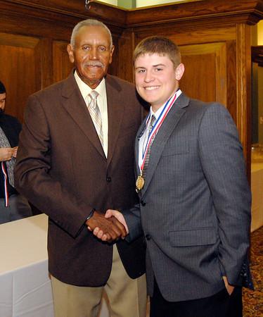 Johnny Wilson with 2013 Johnny Wilson Award nominee Jake Fox of Alexandria High School.