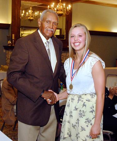 Johnny Wilson with 2013 Johnny Wilson Award nominee Shania Ray of Frankton High School.
