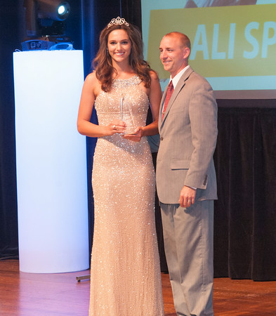 Clarksville High School's, Ali Sparkman, and presenter, Eric Brian, IU Southeast Volleyball coach, pose after Sparkman won the Girls' Student Athlete Award at Thursday's News and Tribune  NTSPY Award Ceremony. Photo by Joe Ullrich