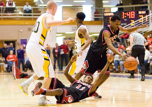 The ball is knocked loose after New Albany senior Javen Reeves and Floyd Central senior Zane Nichols collided during their game at the Seymour Sectional on Tuesday. New Albany won the game, 57-43. Staff photo by Christopher Fryer