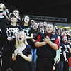 Fans show their support for New albany during the Bulldogs' 47-45 win over Evansville Central in the first round of the Class 4A Regionals held at Seymour Saturday.<br /> Staff photo by Tyler Stewart