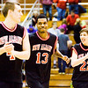From left, New Albany junior Jeff Byrne, senior Leondre McBirth and freshman Isaac Hibbard celebrate following their 57-43 victory over Floyd Central at the Seymour Sectional on Tuesday. Staff photo by Christopher Fryer