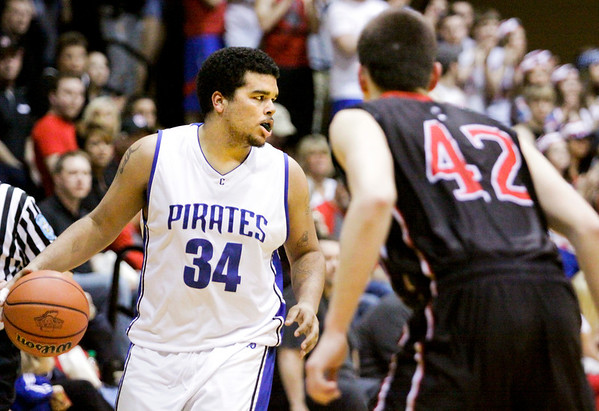 Charlestown forward Darren Taylor moves the ball downcourt during the Pirates' game against Brownstown at the North Harrison Sectional on Friday. Brownstown won the game, 77-41. Staff photo by Christopher Fryer