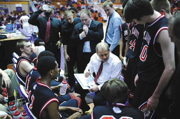 New Albany head coach Jim Shannon utilizes a timeout to get his team back on track during the Bulldogs' 46-45 loss to Bloomington North in the Class 4A Regional Championship at Seymour Saturday evening.<br /> Staff photo by Tyler Stewart