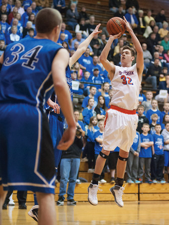Silver Creek junior Gabe Bauer puts up a shot during the Dragons' 70-60 loss in Saturday's Class 3A Washington Regional semifinal against No. 1 Greensburg. Photo by Joe Ullrich