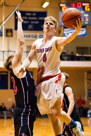 Silver Creek guard Nick Tinsley goes up for a shot during the Dragons' game against Brownstown in the championship round of the North Harrison Sectional on Saturday. Silver Creek won the game, 37-36. Staff photo by Christopher Fryer