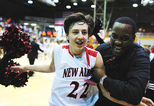 Freshman Isaac Hibbard and assistant coach Ryan Wheeler celebrate as they leave the court after the Bulldogs' 47-45 win over Evansville Central in the first round of the Class 4A Regionals held at Seymour Saturday.<br /> Staff photo by Tyler Stewart