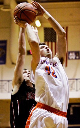 Silver Creek forward Sam Garr goes up for a shot during the Dragons' game against Brownstown in the championship round of the North Harrison Sectional on Saturday. Silver Creek won the game, 37-36. Staff photo by Christopher Fryer