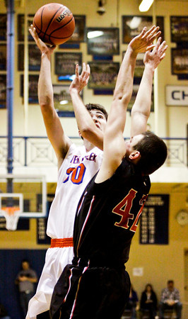 Silver Creek forward Jake Steele goes up for a shot during the Dragons' game against Brownstown in the championship round of the North Harrison Sectional on Saturday. Silver Creek won the game, 37-36. Staff photo by Christopher Fryer