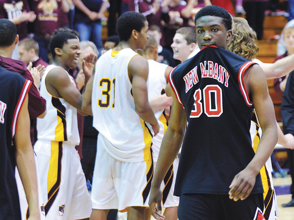 Junior DeAnthony Warren heads off the court after the Bulldogs' 46-45 loss to Bloomington North in the Class 4A Regional Championship at Seymour Saturday evening.<br /> Staff photo by Tyler Stewart