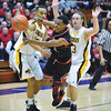 Senior Leondre McBirth gets out of a defensive trap by the Cougars during the Bulldogs' 46-45 loss to Bloomington North in the Class 4A Regional Championship at Seymour Saturday evening.<br /> Staff photo by Tyler Stewart
