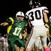 Floyd Central linebacker Brandon Stout closes in on New Albany wide receiver Landon Howard during the second half of their game at Floyd Central on Friday. New Albany won the game, 28-27. Staff phtoo by Christopher Fryer
