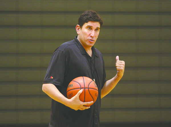 Mark Lieberman, a former University of Louisville assistant men's basketball coach and the new varsity boys' coach at Floyd Central, goes over a drill with players last week at Highland Hills Middle School. Staff photo by C.E. Branham