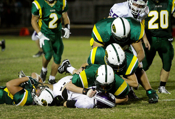 The Floyd Central defense takes down Seymour quarterback Austin Sutton during their game at Floyd Central on Friday. Staff photo by Christopher Fryer
