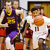 New Albany forward Javen Reeves scrambles for a loose ball during the Bulldogs' home game against Scottsburg on Saturday. New Albany won the game, 77-59. Staff photo by Christopher Fryer