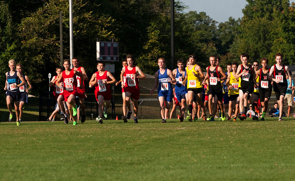 Runners leave the starting line during the men's race of the Bulldog Classic cross country invitational in New Albany on Saturday morning. Staff photo by Christopher Fryer